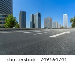 empty road and modern office... | Shutterstock . vector #749164741