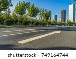 empty road and modern office... | Shutterstock . vector #749164744