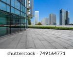 modern buildings and empty... | Shutterstock . vector #749164771