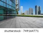modern buildings and empty... | Shutterstock . vector #749164771