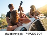 group of happy people in a car... | Shutterstock . vector #749203909