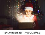 cute girl on a christmas new... | Shutterstock . vector #749205961
