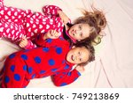 girl sisters in pajamas happy... | Shutterstock . vector #749213869