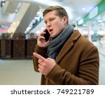man in the coat with the phone... | Shutterstock . vector #749221789