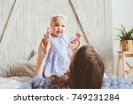 happy mother and 9 month old... | Shutterstock . vector #749231284