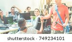 co workers inside creative... | Shutterstock . vector #749234101