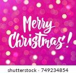 merry christmas text  hand... | Shutterstock .eps vector #749234854
