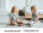 two happy siblings playing with ... | Shutterstock . vector #749239375