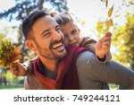 father and daughter have fun... | Shutterstock . vector #749244121
