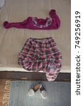 Small photo of Pajama arranged on the bed in awake body position in the bedroom