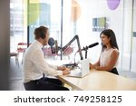 young man interviewing a woman... | Shutterstock . vector #749258125