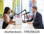 young woman interviewing a... | Shutterstock . vector #749258134