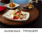octopus salad on a plate with... | Shutterstock . vector #749261839