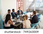 work colleagues having a... | Shutterstock . vector #749263009