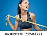 woman with a measuring tape on... | Shutterstock . vector #749265931