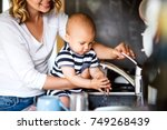 young mother with a baby boy... | Shutterstock . vector #749268439