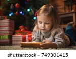 little girl with smartphone at... | Shutterstock . vector #749301415