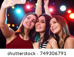 smiling girls with smartphone... | Shutterstock . vector #749306791