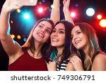 smiling girls with smartphone... | Shutterstock . vector #749306791