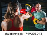 female on boxing class with her ... | Shutterstock . vector #749308045
