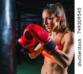 woman on boxing training | Shutterstock . vector #749309545