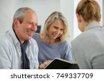 agent selling life insurance to ... | Shutterstock . vector #749337709