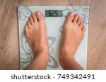 female feet on personal scales  ... | Shutterstock . vector #749342491