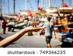 a small souvenir ship on the... | Shutterstock . vector #749346235