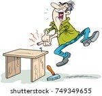 man hitting thumb with hammer | Shutterstock .eps vector #749349655
