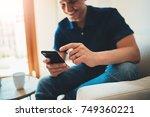 happy smiling man using modern... | Shutterstock . vector #749360221