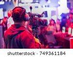 professional video technician... | Shutterstock . vector #749361184