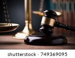law scales and wooden gavel | Shutterstock . vector #749369095