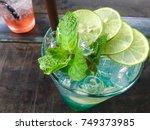 fresh green lemon soda drink... | Shutterstock . vector #749373985