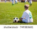young boy as a soccer player....   Shutterstock . vector #749383681