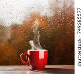 Small photo of Cup of coffee on a rainy day