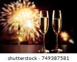 two champagne glasses against... | Shutterstock . vector #749387581