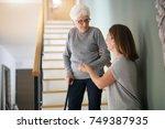 Homecare Helping Elderly Woman...
