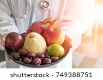 doctor or nutritionist hold... | Shutterstock . vector #749388751