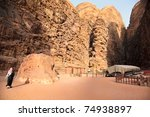 Um Nfoos Mountains, Lawrence of Arabia portrait carving stone and Bedouin touristic guide, Wadi Rum desert, Jordan - stock photo