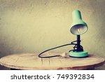retro green desk lamp on ... | Shutterstock . vector #749392834