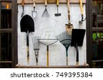 gardening tools on cement wall  ... | Shutterstock . vector #749395384