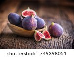 A Few Figs In A Bowl On An Old...