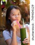 young beautiful asian woman... | Shutterstock . vector #749404129