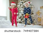 children in christmas | Shutterstock . vector #749407384