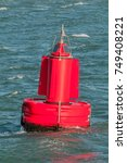 a red buoy is floating on the... | Shutterstock . vector #749408221