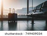 two suitcases in empty airport... | Shutterstock . vector #749409034