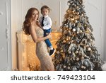 happy mother and baby near the... | Shutterstock . vector #749423104