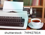 a typewriter and tea. antique... | Shutterstock . vector #749427814