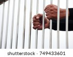 hands of prisoner in jail with... | Shutterstock . vector #749433601