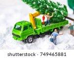 miniature worker passenger... | Shutterstock . vector #749465881